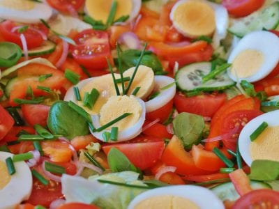 Tossed salad with hard boiled egg slices
