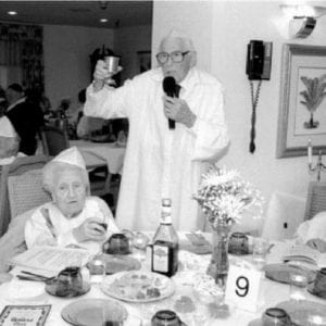 black and white photograph of passover seder at chelsea jewish nursing home in 1972