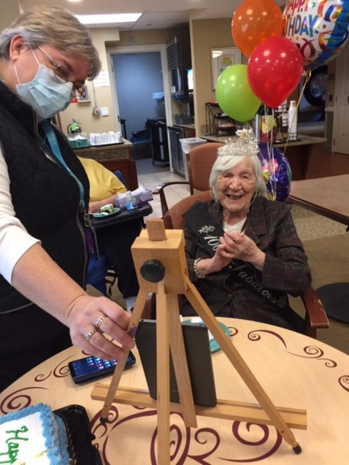 A woman celebrating her 100th birthday