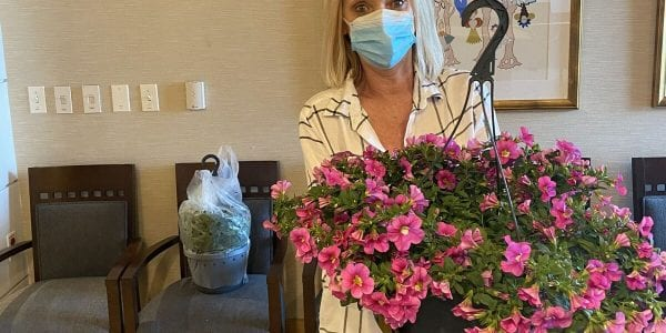Sandie, Activities Assistant at LFCL, prepares to distribute flowers to residents on Mother's Day.