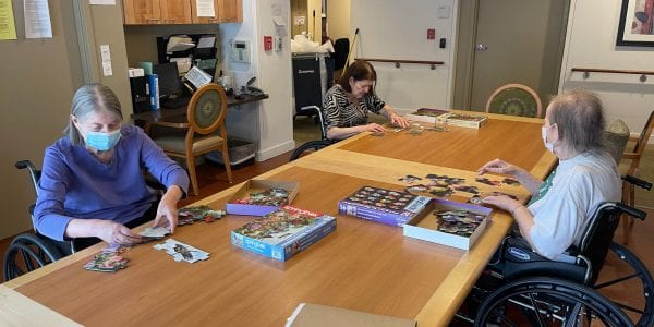 Residents put together puzzles