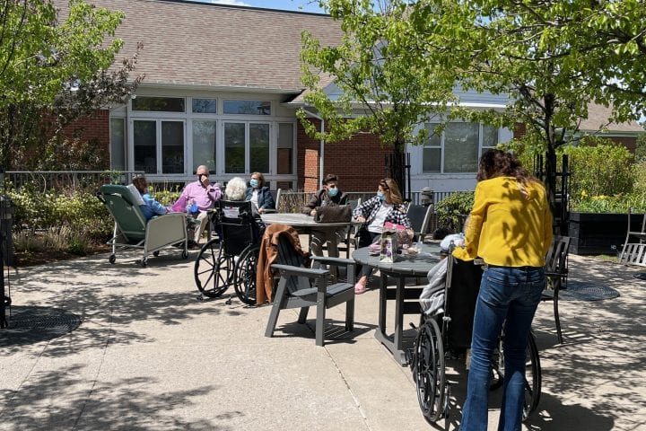Residents sit outside and enjoy the weather