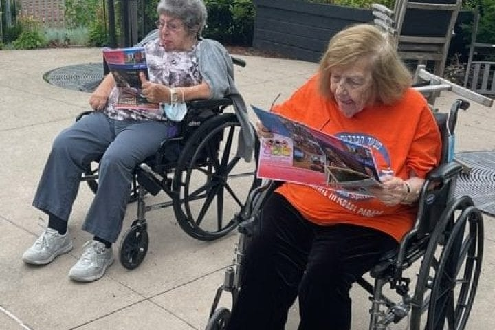 Residents read outside and enjoy the weather
