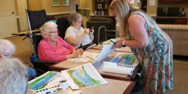 Residents participate in a painting class at Brudnick Center for Living in Peabody, Massachusetts