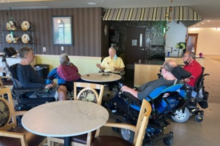 Residents gathering in the cafe at Leonard Florence Center for Living