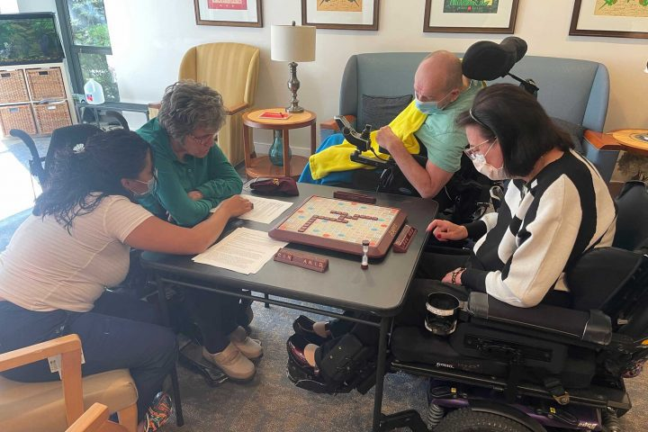 Residents enjoy a game of Scrabble.